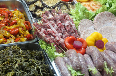 rich buffet with cooked vegetables sausages skewers and cutlets in the restaurant Stock Photo