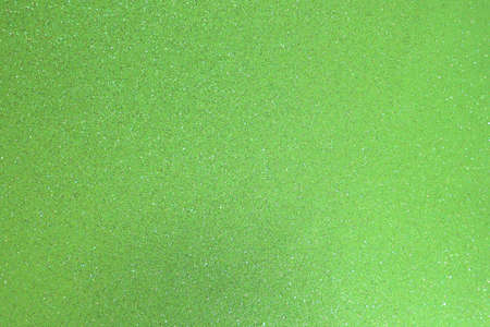 green background with lots of bright shiny glittery glitter ideal as a backdrop in horizontal format
