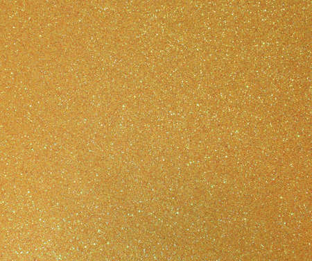 yellow golden background with many glittery shimmering glitter ideal as a backdrop