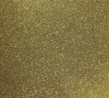 golden background with many glittery shimmering glitter ideal as a backdrop
