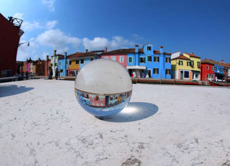big glass sphere in the island of Burano near Venice in Italy without people