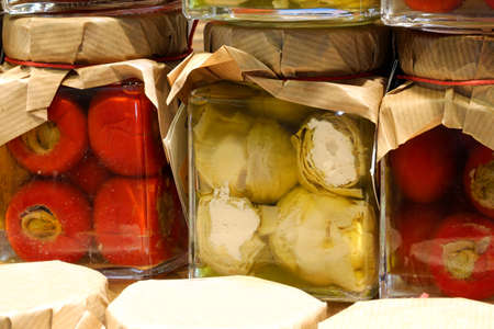 red peppers with tuna inside and artichokes in oil for sale in the Italian shop Stock Photo