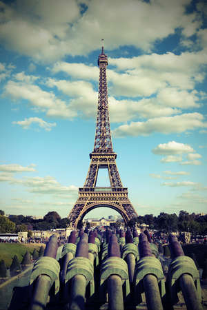 Eiffer tower from Trocadero Quartier in Paris and the cannons with old vintage toned effect Stock Photo