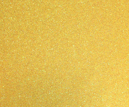yellow golden background with lots of bright shiny glittery glitter ideal as a backdrop Stock Photo
