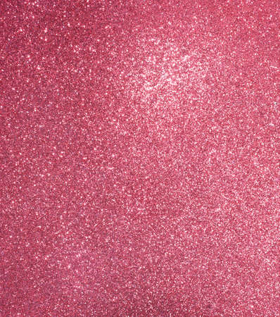 red background with lots of bright shiny glittery glitter ideal as a backdrop Stock Photo
