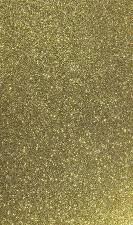 golden background with many glitter ideal as a backdrop for various uses 写真素材
