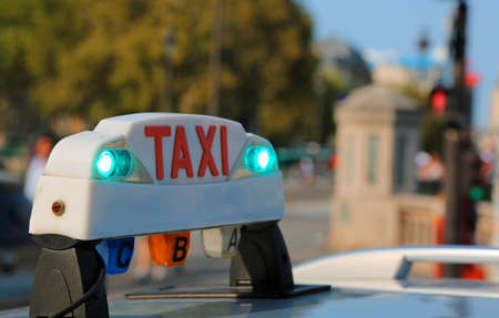 French luminous taxi top sign in Paris France 版權商用圖片