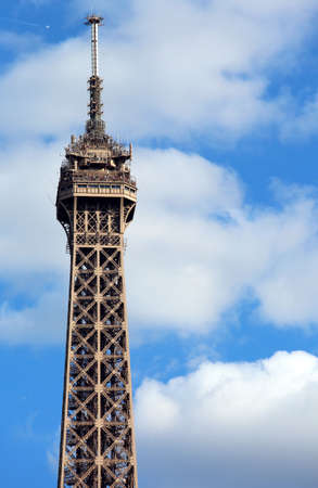 detail of the tip of the Eiffel Tower that soars in the Paris sky