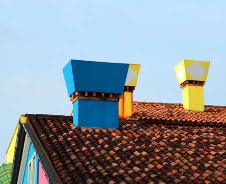 Many colored chimneys in Burano Island near Venice in Italy
