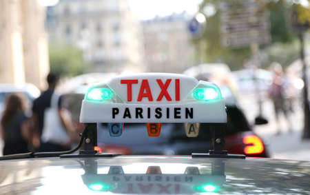 French taxi text with lights in the capital of France in Europe