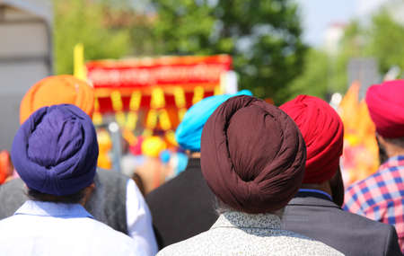 Religious parade with men wearing turban dyes