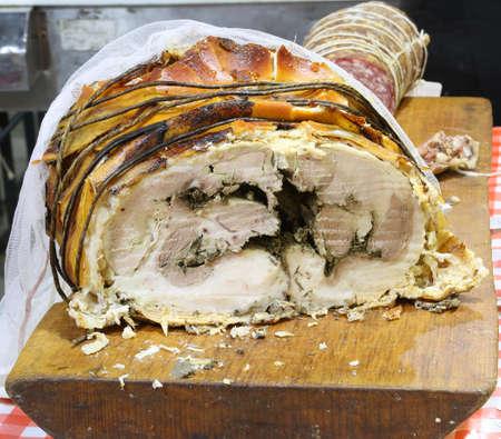 roast pork called Porchetta in Italian language  in the stand of street food