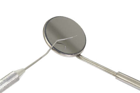 small Mirror and dental tool to remove tartar in the dental clinic Stock fotó