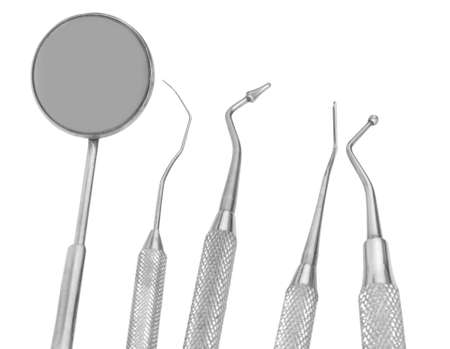 small Mirror and dental tool to remove tartar and more tools in the dental office