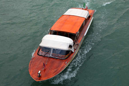 Taxi boat in Venice in Italy in the main waterway called Canal Grande in italian language 版權商用圖片
