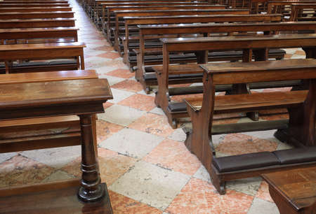 the consequence of the religious crisis are the empty Church pew bench with kneeler inside the Christian churches