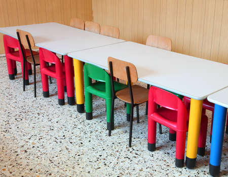 small colored chairs in the classroom of the preschhol