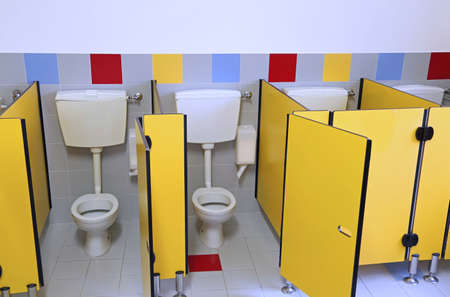 small toilets adn wc of a kindergarten with yellow doors