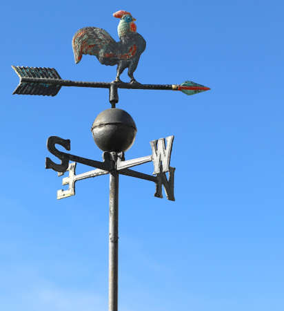 metallic cock vane to indicate the wind direction with the letters of the cardinal points Banco de Imagens