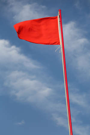 red flag to signal the danger of very rough sea Stok Fotoğraf