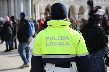 italian policeman with uniform with the text POLIZIA LOCALE which means City Local Police in Italian language during a check Stockfoto