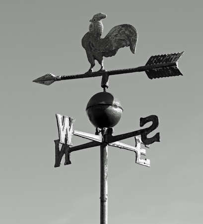 metallic cock vane to indicate the wind direction in black and white