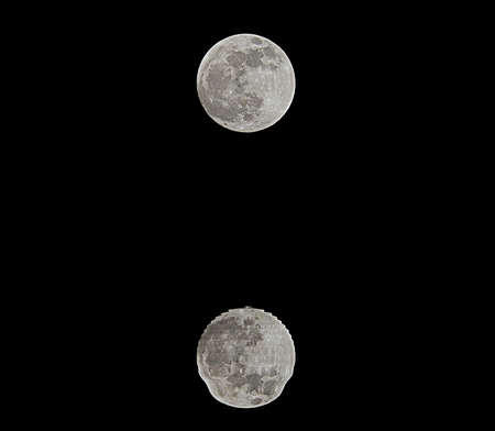 reflections on the sea of a shining full moon in the dark night Stock fotó