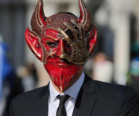 Venice, VE, Italy - February 5, 2018: Devil Mask at the Venice Carnival in Saint Mark Square Фото со стока - 116400511