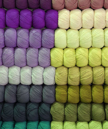 background of balls of many colors  of wool in the store