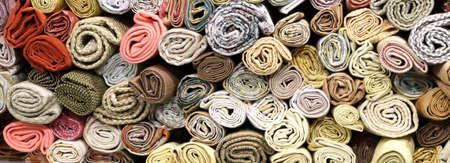 rolls of fabrics on the shelves of the haberdashery