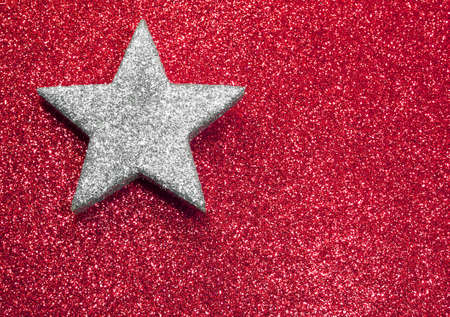 silver star in brilliant red background Stock Photo