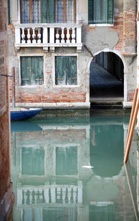 Gate on the navigable canal in Venice Italy and tide