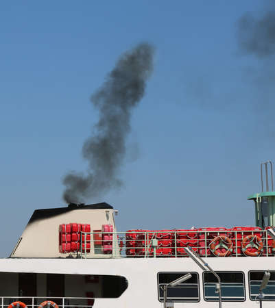 polluted black smog of the boat to transport passengers
