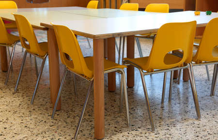 inside a school classroom with small plastic chairs and low tables Stock Photo