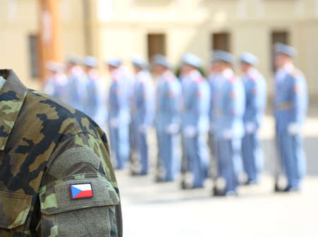 Army soldier uniform with flag of the Czech Republic in Prague during the changing of the guard in the castle and a patrol of guards