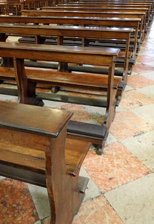 many wooden pews without people inside the church