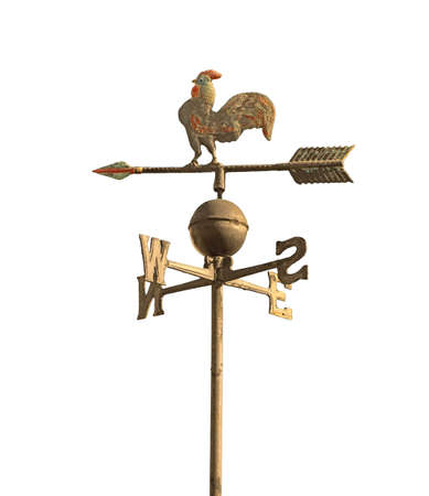 wind vane to indicate the wind direction and the metal cock above the arrow and cardinal points North East South West 스톡 콘텐츠