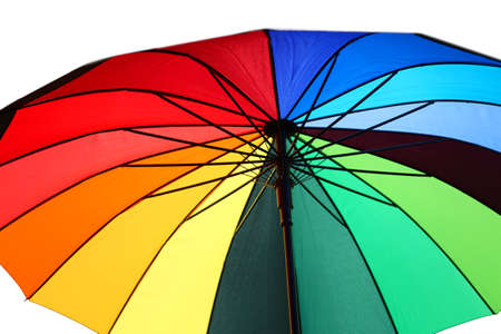 multicolored open umbrella with colorful wedges and white background Reklamní fotografie