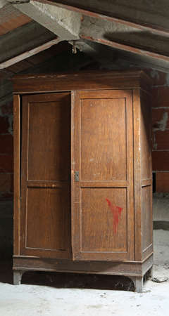 old wooden wardrobe in the dusty attic