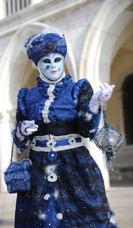 Venezia, VE, Italy - February 5, 2018: Mask of blue woman with handbag at Saint Mark Square Editorial