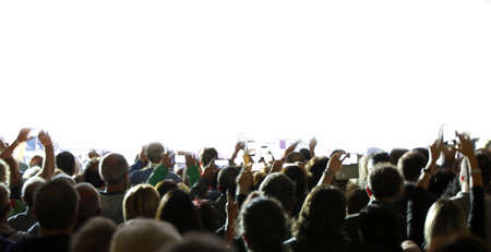 many people with smartphone during a live concert and customizable white background