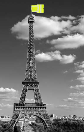 flag like a jackets symbol of Yellow vests movement on Eiffel Tower in Paris seen from the Trocadero in black and White effect Stock Photo