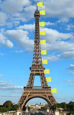 flags like made with jackets symbol of Yellow vests movement on Eiffel Tower in Paris France