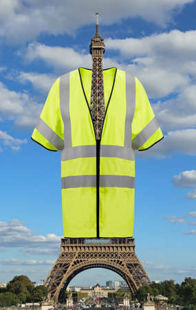 Very Big jacket symbol of Yellow vests movement on Eiffel Tower in Paris France. This is a photomontage Stock Photo