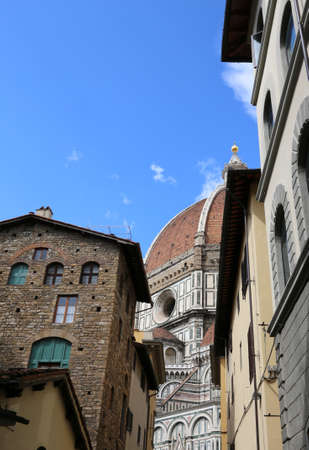 dome of the Duomo of the city of Florence between the houses of the historic center in Italy