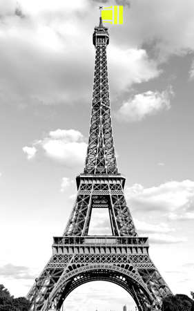 Big jacket such as a flag symbol of Yellow vests movement on Eiffel Tower in Paris France Stock Photo