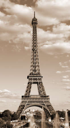 Eiffel Tower symbol of Paris in France in sepia toned effect with clouds