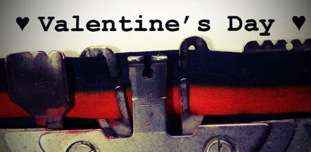 text by  typewriter Valentines Day in black ink with vintage toned effect Imagens