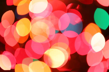 intentionally blurred lights and colors ideal as a backdrop for the holidays and christmas