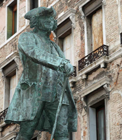 Ancient sculpture of CARLO GOLDONI an italian playwright in Venice Italy Banco de Imagens